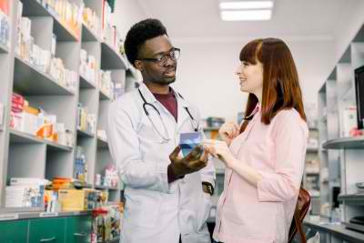 male pharmacist assisting a customer