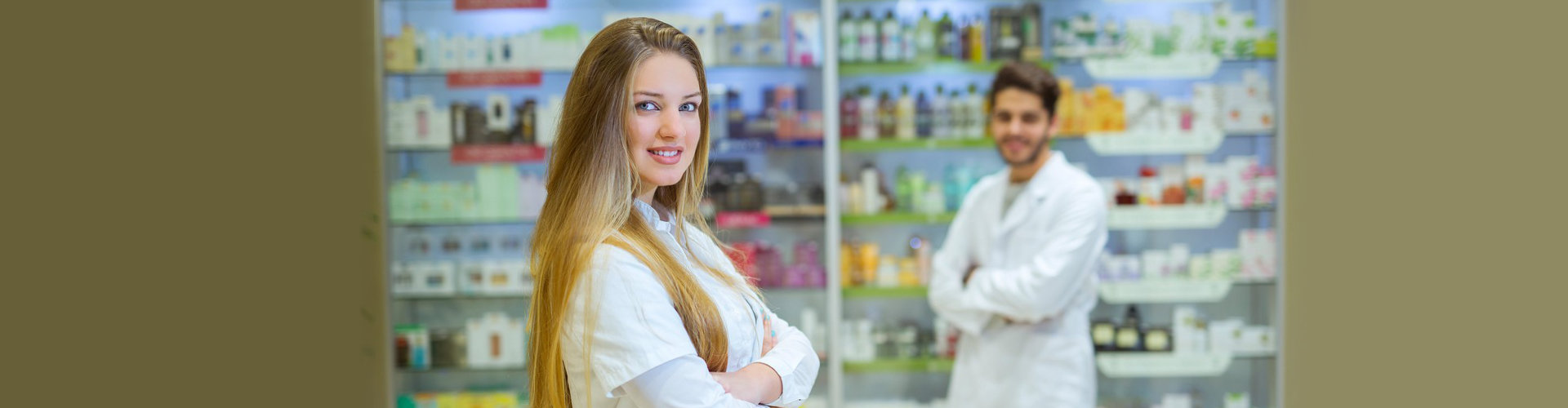 male and female pharmacist standing in front of pharmacy products